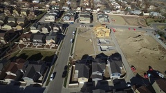 Rows of similar homes sit in a residential community in a rural area Stock Footage