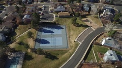 A flyover of tennis courts in a residential area  Stock Footage