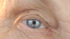 Blue eye of middle-aged woman. Close up Stock Footage