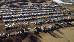 Clockwise orbital shot from low altitude of parked recreational vehicles Stock Footage