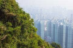 Hong kong tall buildings in haze Stock Photos