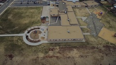 A playground set sits behind a large school building COLORADO Stock Footage
