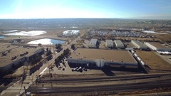 Overview of a town full of industrial buildings and parking areas COLORADO Stock Footage