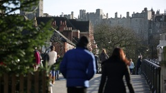 Anonymous crowds in Windsor: Eton Bridge Stock Footage