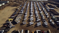 Aerial of rvs parked in an open flat area by a river COLORADO Stock Footage