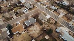 Aerial views of homes line streets, COLORADO Stock Footage