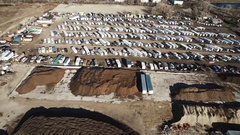 A number of vehicles are placed in a large open area COLORADO Stock Footage