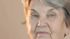 Portrait of a old smiling woman Stock Footage