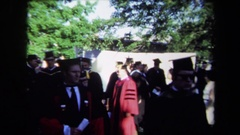 1971: people walking at graduation SACRAMENTO CALIFORNIA Stock Footage