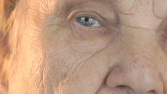 Old woman opening and closing eyes Stock Footage
