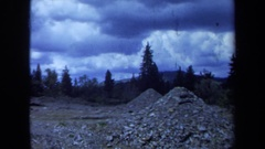 1971: dozer with piles of rocks in a valley MAINE Stock Footage