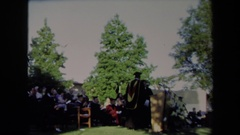 1971: alumni comes to the podium to speak after another speaker. SACRAMENTO Stock Footage