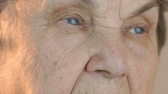 Old woman's face with tired expression of face Stock Footage