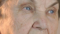 Elderly woman's face with tired expression of face Stock Footage