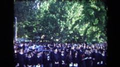 1971: large graduation ceremony on a windy day SACRAMENTO CALIFORNIA Stock Footage