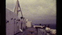 1983: sailors on the deck of a ship in choppy waters. DENMARK Stock Footage