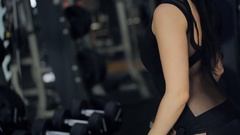 Athletic women do exercises with dumbbell in a fully-stocked gym Stock Footage
