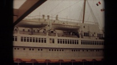 1971: flags from various countries hang on a line on ship LONG BEACH CALIFORNIA Stock Footage