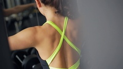 Women work with equipment in gym. View from her back Stock Footage