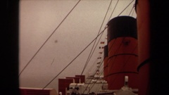 1971: the exhaust funnels of a large ship line the deck while a rope line behind Stock Footage