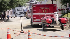 """""""Road Closed"""" sign at flood damaged disaster, water rescue vehicle Stock Footage"""