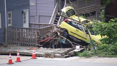 Wreckage of car after flood damage and disaster in a small town Stock Footage