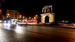 Moving cars under hadrian gate Stock Footage