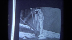 1970: looking at an astronaut picture CALIFORNIA Stock Footage