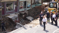 Emergency service workers at flood damaged street after a disaster. Wide. Stock Footage