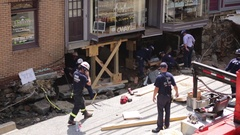Emergency services at disaster site. Flood damage destroyed building foundation. Stock Footage