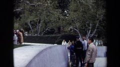 1970: a soldier in black points towards a grave site at a funeral WASHINGTON DC Stock Footage