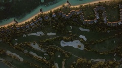 Tropical island with houses on the coast, aerial view Stock Footage