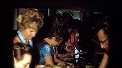 1971: number of people gathered together in a room are enjoying CALIFORNIA Stock Footage