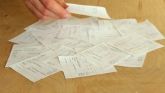 Woman sorting receipts. Track Spending Stock Footage