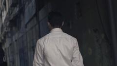 Man walking down the street Stock Footage