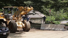 Emergency construction services at a disaster site setting up road blocks. Stock Footage