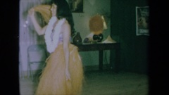 1961: a woman luau dances in her own home CALIFORNIA Stock Footage