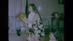 1961: young women dressed in traditional costumes play instruments Stock Footage