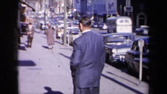 1959: man in suit walking along parked cars NEW YORK Stock Footage