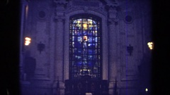 1970: picture of jesus in front of clouds and beneath candles in the window  Stock Footage