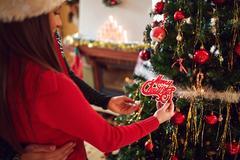 Couple decorate Christmas tree, close up Stock Photos