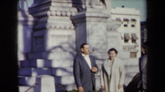 1959: several people pose in front of a monument in a city in autumn time  Stock Footage