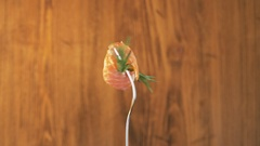 Rotating Fork With Salmon and Rosemary on Wooden Background Stock Footage