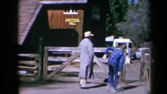 1969: people walk towards a wood building named daffodil hill CALIFORNIA Stock Footage