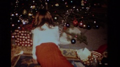 1984: a girl unwrapping her christmas presents CALIFORNIA Stock Footage