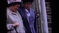 1958: two older women leave a church together walking arm in arm NEW YORK Stock Footage