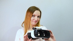 Young woman with virtual reality headset or 3d glasses playing game at home Stock Footage