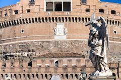 Angel statue on bridge Ponte Sant Angelo in Rome Stock Photos