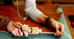 Close-up of craftswoman cutting leather Stock Footage