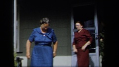 1958: three middle aged women going out for a casual stroll in the morning  Stock Footage
